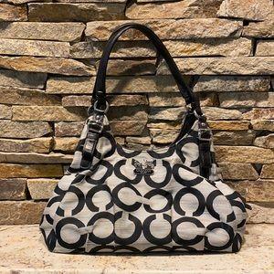 Coach signature purse with black leather straps